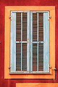 "Typical French window on residential building in the ""Vielle Ville"" (old town) part of Nice, France"