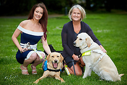 © Licensed to London News Pictures. 25/05/2016. LONDON, UK.  Photocall organised by Guide Dogs for the Blind. The charity is highlighting the daily difficulties faced by guide dogs users including taxis and businesses refusing to allow the animals inside. in this picture: Reality TV star JESS IMPIAZZI with her blind mother DEBBIE IMPIAZZI and six year old guide dogs Clover (left) and Kacey (right).  Photo credit: Cliff Hide/LNP