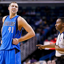 November 17, 2010; New Orleans, LA, USA; Dallas Mavericks power forward Dirk Nowitzki (41) of Germany talks with referee James Capers (19) during the first half of a game against the New Orleans Hornets at the New Orleans Arena. Mandatory Credit: Derick E. Hingle