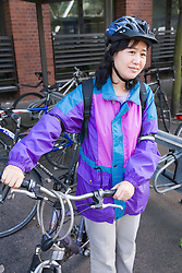 Woman with her bike in a works bike shed,