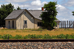 Old neglected and abandoned buildings and homes dot the landscape of northwest Nebraska