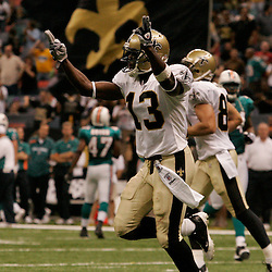 2009 September 03: New Orleans Saints wide receiver Rod Harper (13) celebrates after scoring on a punt return during a preseason game between the Miami Dolphins and the New Orleans Saints at the Louisiana Superdome in New Orleans, Louisiana.