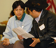 11/11/06 Omaha, NE Noe Diego (left) and Jose Juarez sing a song at a dinner at the Our Lady of Guadalupe social hall Saturday evening..(Chris Machian/fPrairie Pixel Group)..