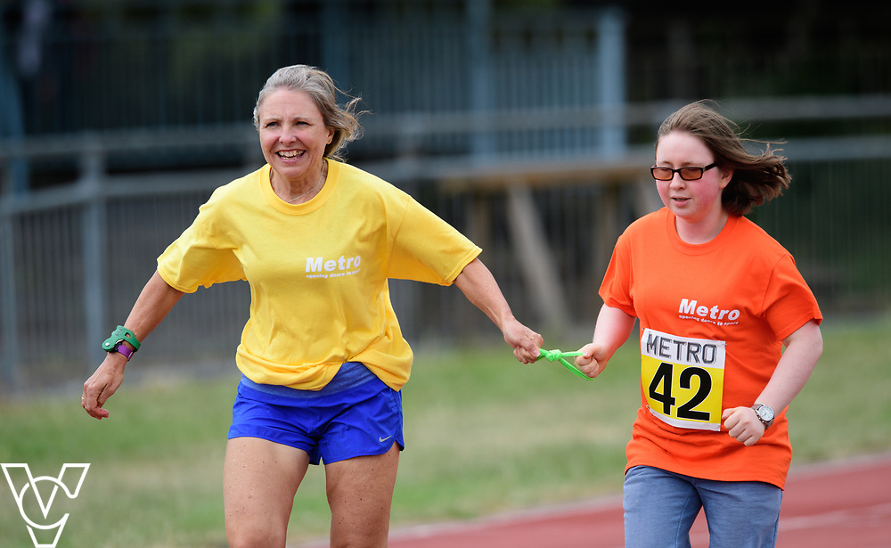 Event: 200 meters<br /> Competitors, from left: Amber Rogers<br /> <br /> Metro Blind Sport's 42nd Athletics Open, held at Mile End Stadium, Tower Hamlets, London.<br /> <br /> Picture: Chris Vaughan Photography for Metro Blind Sports<br /> Date: June 16, 2018