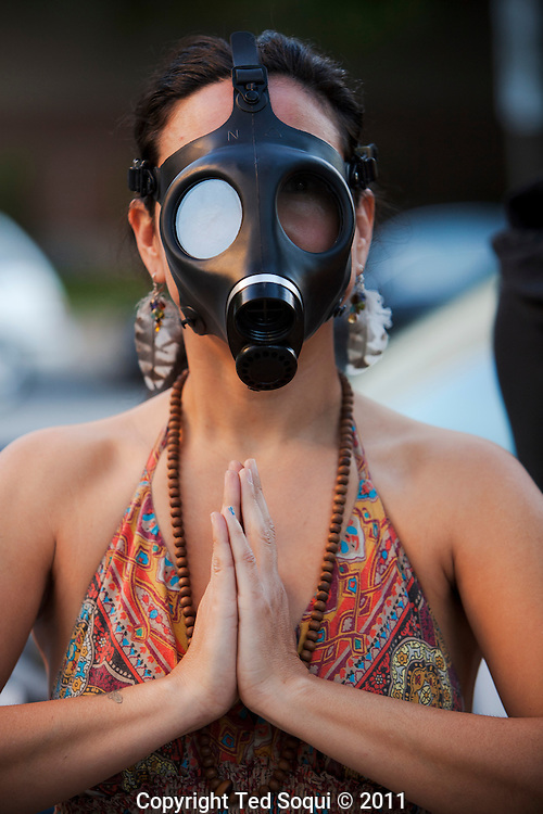 A gas mask vender..Occupy L.A. last day before getting evicted. Mayor Antonio Villaraigosa has set up a deadline of 12:01am Monday morning for the campers to be gone from the city hall lawn.