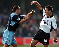 Photo. Javier Garcia<br />16/02/2003 Fulham v Burnley, FA Cup 5th Round, Loftus Road<br />Burnley's Dean West, left and Fulham's Jon Harley have a first half disagreement