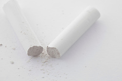 Stick chalk broken still life white paper close up