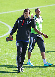 NEWPORT, WALES - Tuesday, October 7, 2014: Wales' manager Chris Coleman and captain Ashley Williams training at Dragon Park National Football Development Centre ahead of the UEFA Euro 2016 qualifying match against Bosnia and Herzegovina. (Pic by David Rawcliffe/Propaganda)