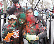 The Padassie family celebrate the Spring holiday of Holi, by throwing colored powders and spraying colored water on each other to chase away the gray of winter.  The festival took place on Liberty Ave, and most of the powder was thrown in Smoky Oval Park in Richmond Hill Queens..Photo by Nancy Siesel