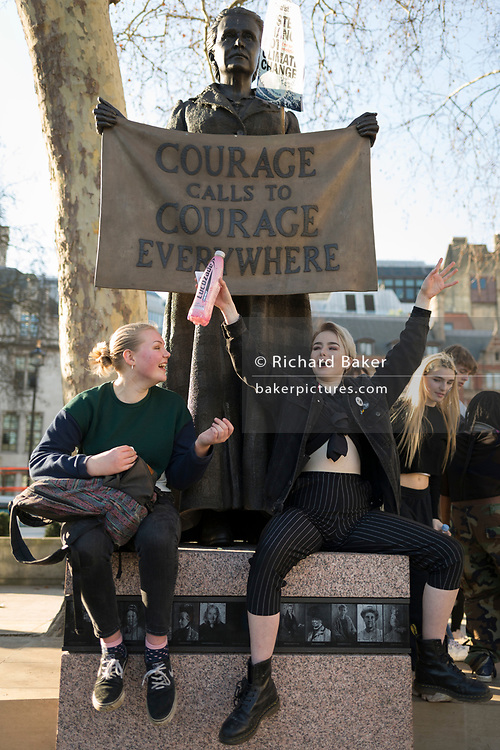 Inspired by Swedish teenager Greta Thunberg and organised by Youth Strike 4 Climate, British eco-aware school and college-age pupils protest about Climate Change at the Suffragist Millicent Garrett Fawcett in Parliament Square during their walkout from classes, on 15th February 2019, in Westminster, London England.