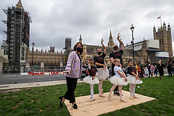 "© Licensed to London News Pictures. 26/10/2020. LONDON, UK.  Choreographer Arlene Phillips (L) joins ballet dancers performing during ""Survival in the Square"", on day one of a week long series of creative taking place each day in Parliament Square.  The events is organised by #WeMakeEvents, an international movement to highlight that the live events sector urgently needs support from local governments to survive the Covid-19 crisis.  Photo credit: Stephen Chung/LNP"