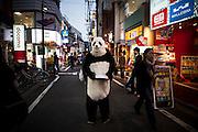 TOKYO, JAPAN, 28 APRIL - ShimoKitaZawa- A Panda give some commercial prospectus for a mobile phone compagny - APRIL 2012 un panda donne des prospectus dans la rue