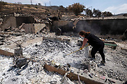 A friend of home owner, surveys the charred debris left in a burned out home, Monday, Sept. 4, 2017, in the Sunland-Tujunga of Los Angeles, the United States, on Sept. 4, 2017. More than 1,000 firefighters work for a fourth day to put out a 7,000-acre brushfire that is 30 percent contained, as the last of the residents ordered to evacuate the record-setting blaze were expected to<br /> return to their homes authorities said. (Xinhua/Zhao Hanrong)(Photo by Ringo Chiu)<br /> <br /> Usage Notes: This content is intended for editorial use only. For other uses, additional clearances may be required.
