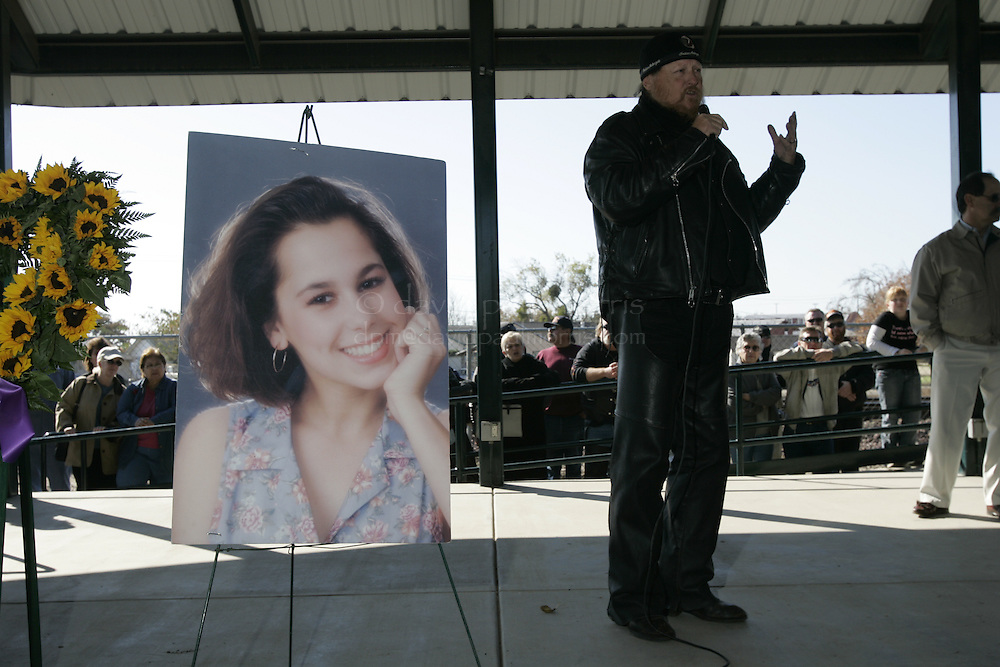 Modesto, CA - NOVEMBER 20: Mickey Jones speaks to the crowd at a dedication in Escalon, California.  Over 2,000 people take part in the second annual Laci Peterson Memorial Motorcycle ride in Modesto, California on Saturday November 20, 2004. Laci was murdered along with her unborn son, Conner in December 2002 by her husband Scott Peterson who was found guilty of  first degree of murder by a San Mateo, California jury on November 12, 2004 and could face the death penalty. Photograph by David Paul Morris