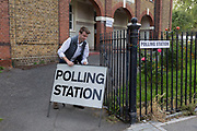 Before voting for the European Elections commences at 7am, an official carries a Polling Station sign to the entrance of St. Saviour's church hall in Herne Hill, on 23rd May 2019, in Lambeth, south London, England UK.