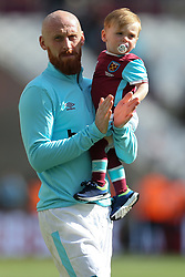 14 May 2017 - Premier League Football - West Ham United v Liverpool - James Collins of West Ham and his son - Photo: Charlotte Wilson