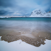 Sea and snow meet at Vik Beach, Vik, Vestvågøy, Lofoten Islands, Norway