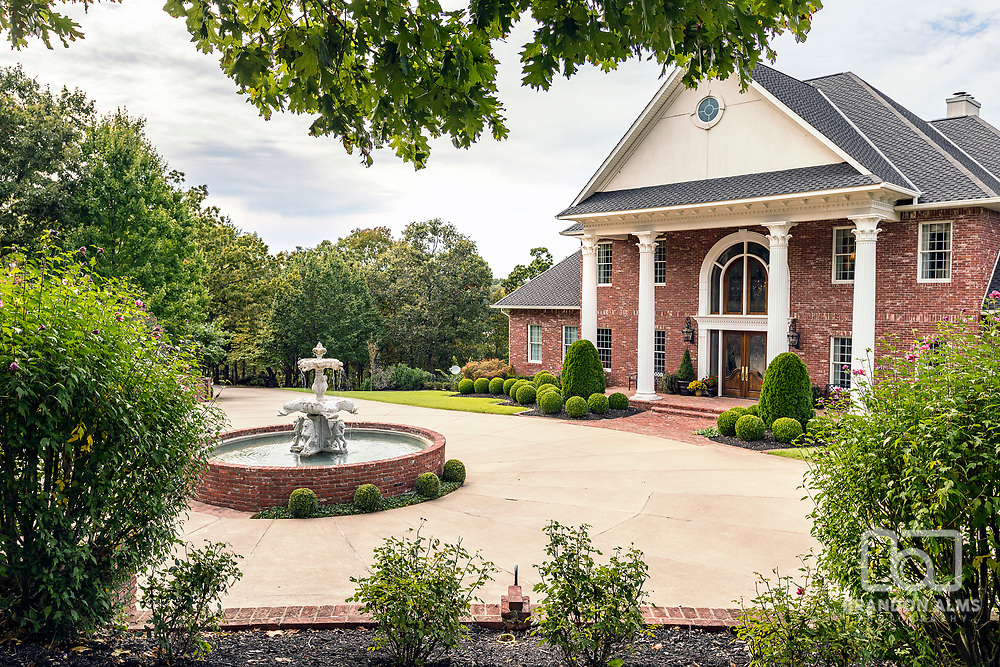 Front Exterior photography of a large mansion. Photo by Brandon Alms Photography