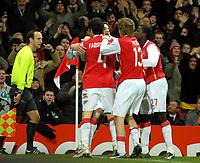 Photo: Ed Godden.<br /> Arsenal v Hamburg. UEFA Champions League, Group G. 21/11/2006. Robin Van Persie celebrates his goal with his Arsenal team mates.