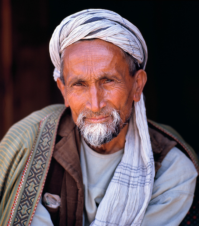 A local merchant engages the camera in the bazaar of Tashkurghan, Afghanistan.