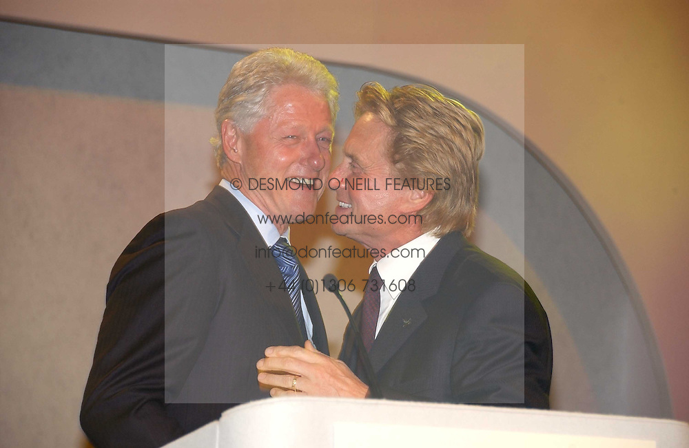 Left to right, Former President of the USA BILL CLINTON and actor MICHAEL DOUGLAS  at the Fortune Forum Dinner held at Old Billingsgate, 1 Old Billingsgate Walk, 16 Lower Thames Street, London EC3R 6DX<br /><br />NON EXCLUSIVE - WORLD RIGHTS