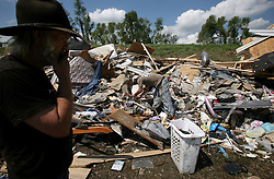 20 September 2012. Scarsdale, Plaquemines Parish, Louisiana,  USA. .Copper scavenger Parrish Poole and his father Gaines (black hat) dig in a pile of debris for copper along highway 39 following flooding that inundated the parish with Hurricane Isaac. .Photo; Charlie Varley.