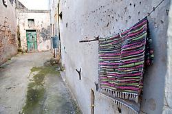Leverano (LE) - Tappeto messo ad asciugare in una viuzza del centro storico.