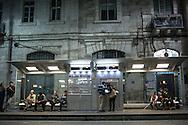People wait on the next tram (light rail) to arrive at a station on Jaffa St in Jerusalem.