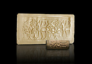 Hittite cylinder seal depicting a scene of animals, seal in foreground and impression standing behind.. Adana Archaeology Museum, Turkey. Against a black background .<br /> If you prefer to buy from our ALAMY STOCK LIBRARY page at https://www.alamy.com/portfolio/paul-williams-funkystock/hittite-art-antiquities.html . Type - Adana - in LOWER SEARCH WITHIN GALLERY box. Refine search by adding background colour, place, museum etc<br /> <br /> Visit our HITTITE PHOTO COLLECTIONS for more photos to download or buy as wall art prints https://funkystock.photoshelter.com/gallery-collection/The-Hittites-Art-Artefacts-Antiquities-Historic-Sites-Pictures-Images-of/C0000NUBSMhSc3Oo