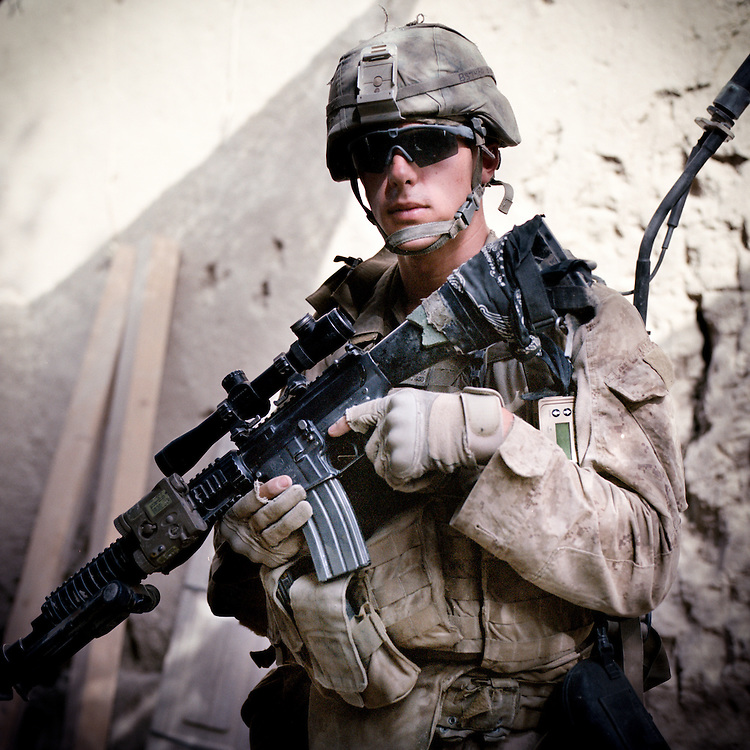 """Location:<br /> Patrol Base Fires, Sangin District, Helmand Province, Afghanistan<br /> <br /> Unit: <br /> 3rd Squad, 1st Platoon, Bravo Company, 1st Battalion, 5th Marines<br /> <br /> Name and Rank: Lance Corporal Brian Shearer<br /> <br /> Age: 20<br /> <br /> Hometown: Rapid City, South Dakota<br /> <br /> Why did you join the Marine Corps?<br /> <br /> """"I joined the Marine Corps because that's all I ever wanted to do, even ever since I was a little kid. It's just, I feel like everybody should serve. Everyone lives in America and a lot of people take it for granted, what they have, and don't do anything about it. And so I think, I joined because it's just my way of being able to give back to being able to live in a free country.""""<br /> <br /> What do you think about the Taliban?<br /> <br /> """"They're good at what they do. They know how to emplace their IEDs. They know how to attack from multiple positions, and they're really able to maneuver on you, but mainly because they can blend in with the populace. I mean, they've been fighting forever, so it's nothing you wouldn't expect.""""<br /> <br /> What's the hardest part about being out here?<br /> <br /> """"Definitely the hardest part about being out here is watching your friends get killed or altered for the rest of their life. That's definitely the hardest part.""""<br /> <br /> Describe the rigors of patrolling:<br /> <br /> """"Patrolling, just, you do what you gotta do. You just get wet a lot. Hygienically, you're constantly dirty. Everyone's bodies are constantly messed up in some way. Everyone's got foot problems and all sorts of body problems . . .<br /> <br /> . . . you get really bad trench foot from being in water all day and then you stay in your socks and you can never get your feet dry or clean.""""<br /> <br /> What will you tell people about what you saw out here?<br /> <br /> """"I won't tell anybody anything, I mean, nobody really . . . nobody wants to know what anybody saw or did out here. If you really wanna """