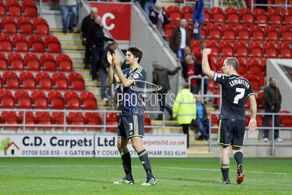 George Friend and Grant Leadbitter celebrate the 3-0 win during the Sky Bet Championship match between Rotherham United and Middlesbrough at the New York Stadium, Rotherham, England on 1 November 2014.