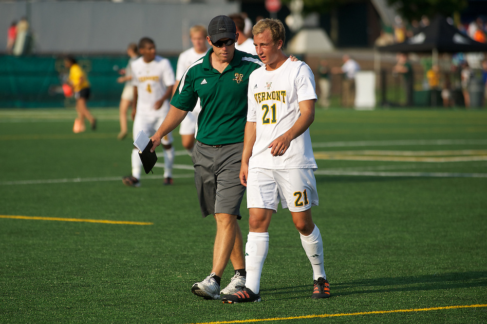 Catamounts head coach Jesse Cormier talks with Catamounts midfielder Danny Childs (21) during the men's soccer game between the Central Connecticut State University Blue Devils and the Vermont Catamounts at Virtue Field on Friday afternoon September 7, 2012 in Burlington, Vermont.