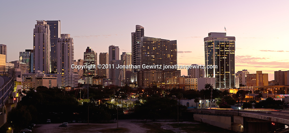 Panoramic twilight view of Miami's downtown and Brickell area just south of the Miami River, showing highrise condo, office and rental apartment buildings WATERMARKS WILL NOT APPEAR ON PRINTS OR LICENSED IMAGES.