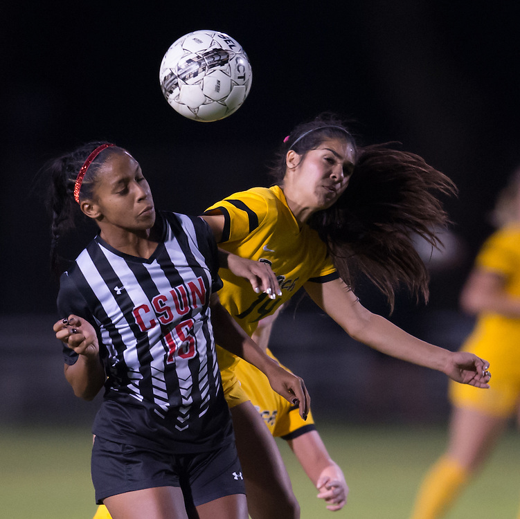CSUN player goes up for header along with Long Beach State player During the Big West Tournament  on George Allen Field on the campus of Cal State Long Beach Thursday, November 3, 2016<br /> <br /> <br /> Photo by Annette Wilkerson/SportsShooterAcademy