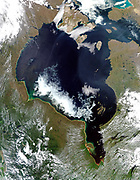 Nelson River and Hudson Bay shown in an image from the True-colour Moderate Resolution Imaging Spectroradiometer (MODIS). The Nelson River emptying spring runoff from the Manitoba province to the south into the south-western corner of Canada's Hudson Bay. The warmer waters from more southern latitudes hasten melting of ice near the shore