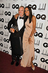 Designer of The Year TOMMY HILFIGER and ROSARIO DAWSON at the GQ Men of the Year 2011 Awards dinner held at The Royal Opera House, Covent Garden, London on 6th September 2011.