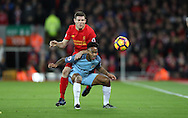 Raheem Sterling of Manchester City is tackled by James Milner of Liverpool during the English Premier League match at Anfield Stadium, Liverpool. Picture date: December 31st, 2016. Photo credit should read: Lynne Cameron/Sportimage