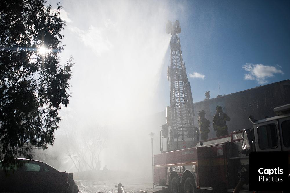 Firefighters battle a four alarm blaze in Deerfield off Baseline road. April 18, 2015
