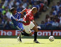 Photo: Richard Lane/Sportsbeat Images.<br />Manchester United v Chelsea. FA Community Shield. 05/08/2007. <br />United's Wes Brown is challenged by Chelsea's Florent Malouda.