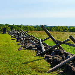 Gettysburg, PA, USA - September 6, 2020: A typical stone wall with fallen wood posts in the Gettysburg National Military Park.