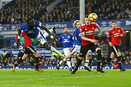 Oumar Niasse of Everton (l) heads towards goal but sees his effort go wide of the goal. Premier league match, Everton v Manchester Utd at Goodison Park in Liverpool, Merseyside on New Years Day, Monday 1st January 2018.<br /> pic by Chris Stading, Andrew Orchard sports photography.