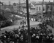 Crowds throng the intersection of SE Morrison St. at Grand Ave. anticipating the beginning of the second annual School Children's Parade, June 9, 1911. 4200 children participated and at least 100,000 attended. The camera is looking west, in the background is the intersection of Union (now MLK). (reconstructed identification. This was the second annual childrens parade. The first took a different route. The car on the right is a 1910 Oldsmobile.)