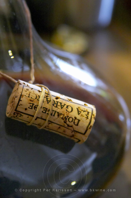 The cork tied in a sting around the neck of the decanter. Domaine de la Garance. Pezenas region. Languedoc. Wine aerating in a carafe. France. Europe.