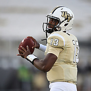 ORLANDO, FL - OCTOBER 09:  Quarterback Justin Holman #13 of the UCF Knights of the UCF Knights is seen in warmups at Bright House Networks Stadium on October 9, 2014 in Orlando, Florida. (Photo by Alex Menendez/Getty Images) *** Local Caption *** Justin Holman