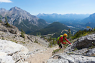 The Via Ferrata on Mt. Norquay, Banff National Park, Canada.  Via Ferrata (Italian for Iron Road) is a trail making method used in the mountains to make passage easier and more secure. It is done by a installing steel steps, handles, ladder rungs, and a steel cable in the places where the trail steepens. Travellers are secured to the rock by wearing a harness that is always attached to the steel cable.<br /> The Norquay VF is designed to accommodate beginners seeking a taste of the alpine, and to accommodate folks who already have a little alpine experience. The Norquay Via Ferrata is located on the cliffs above The Cliffhouse Bistro at the top of the North American Chairlift.<br /> In total there's about 300m of Via Ferrata  and about 1350m of trail.