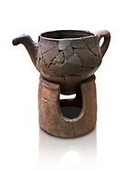 Hittite terra cotta teapot with strainer spout on a charcoa; burner base  . Hittite Period, 1600 - 1200 BC.  Hattusa Boğazkale. Çorum Archaeological Museum, Corum, Turkey. Against a white bacground. .<br />  <br /> If you prefer to buy from our ALAMY STOCK LIBRARY page at https://www.alamy.com/portfolio/paul-williams-funkystock/hittite-art-antiquities.html  - Hattusa into the LOWER SEARCH WITHIN GALLERY box. Refine search by adding background colour, place,etc<br /> <br /> Visit our HITTITE PHOTO COLLECTIONS for more photos to download or buy as wall art prints https://funkystock.photoshelter.com/gallery-collection/The-Hittites-Art-Artefacts-Antiquities-Historic-Sites-Pictures-Images-of/C0000NUBSMhSc3Oo