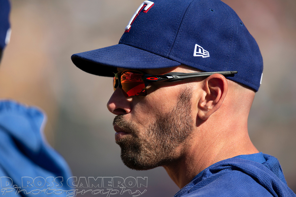 Texas Rangers manager Chris Woodward (8) watches his team take on the Oakland Athletics during the eighth inning of a baseball game, Sunday, Sept. 22, 2019, in Oakland, Calif. (AP Photo/D. Ross Cameron)
