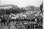 03/07/1963<br /> 07/03/1963<br /> 03 July 1963<br /> RGDATA Turnover Tax Protest March in Dublin. Picture shows the hundreds of grocers swarm to Government Buildings to present their protest to against the proposed Turnover Tax to the Minister for Finance, but  you could hear a pin drop.