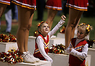 Cierra Johnson, 5, granddaughter to head coach Bob Johnson, and daughter to offensive coordinator Bret Johnson, cheers with friend Madison Braunstein, 5, of Aliso Viejo, while the Diablos defeated Trabuco Hills 54-14 Friday October 28, 2005.