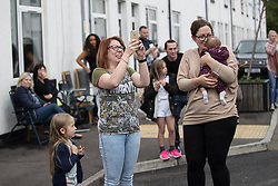 © Licensed to London News Pictures . 04/09/2017 . Manchester , UK . Children and families come out in to the street to see Prince Harry visit the Walking With the Wounded ( WWTW) hub on Canada Street , Newton Health .  WWTW helps ex-service personnel with physical or mental health needs make the transition back to civilian life . The street was subject to an episode of DIY SOS when people gave their time and resource to help redevelop the houses . Photo credit : Joel Goodman/LNP